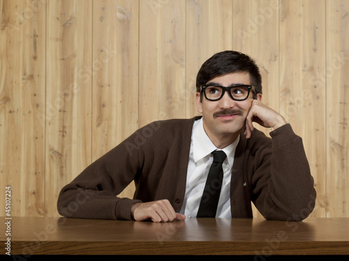 Bored businessman at desk in office