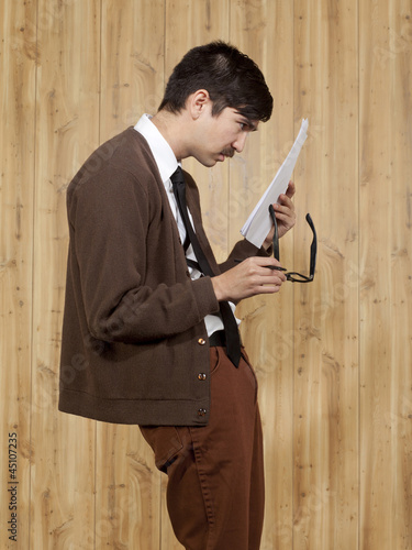 Businessman reading document in office
