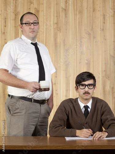 Portrait of two businessmen working in office