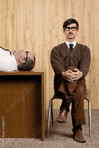 Bored businessmen resting in office