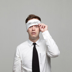 Studio portrait of young man with blindfold