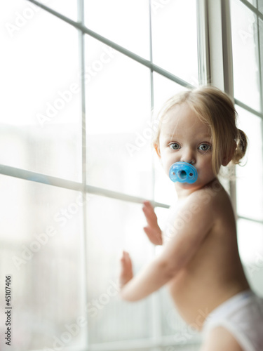 """USA, Utah, Orem, Portrait of girl (2-3) with pacifier in her mouth"""