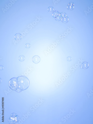 Studio shot of bubbles against blue background