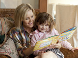 """USA, Utah, Cedar Hills, Mother reading children's book to daughter (4-5)"""
