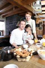Young family gathered in the kitchen