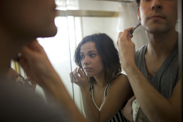 """USA, Utah, Provo, Close-up of young couple in front of bathroom mirror"""