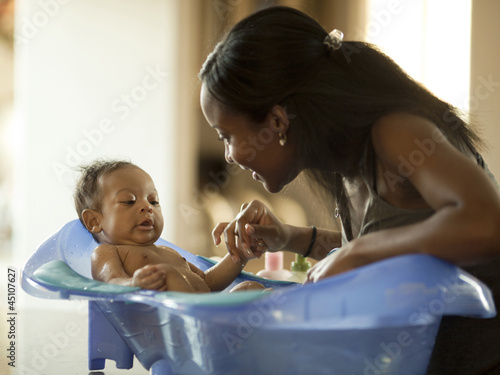 """USA, Utah, Cedar Hills, Mother with baby boy (0-1 months) in bathtub"""