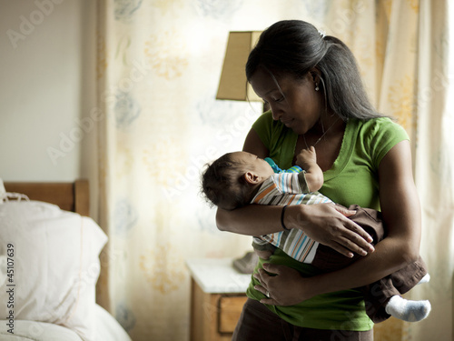 """USA, Utah, Cedar Hills, Mother with newborn baby boy ( 0-1 months) sleeping in her hands"""