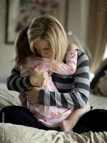 """USA, Utah, Cedar Hills, Mother embracing young daughter (4-5)"""