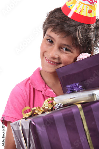 child with birthday gifts