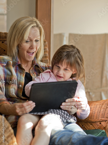 """USA, Utah, Cedar Hills, Mother and daughter (4-5) using digital tablet"""