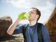 man drinking water in the desert