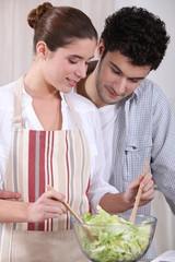 Husband and wife preparing salad