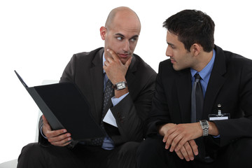 Businessmen discussing a file