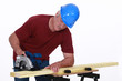 Woodworker using circular saw