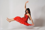 Woman fly with red dress- levitation isolated white background