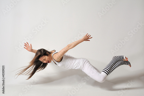 Woman fly - levitation isolated white background
