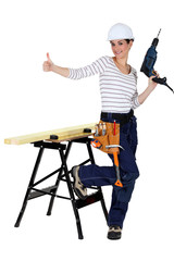 happy-looking female carpenter thumb up