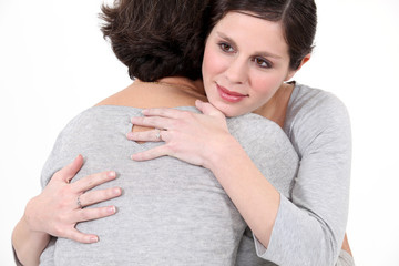 young woman hugging mother