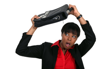 Woman protecting her head with a suitcase