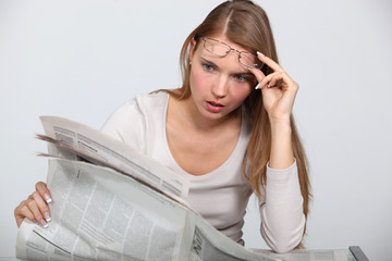 Woman shocked by newspaper article