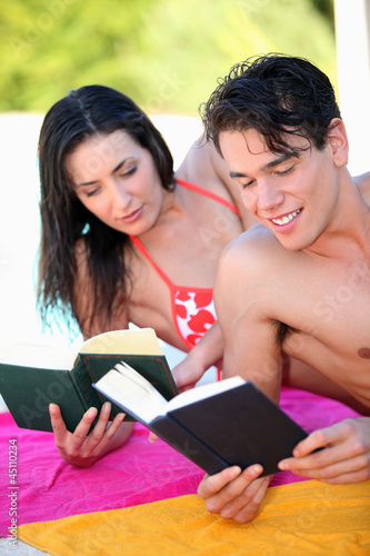 couple reading on the beach