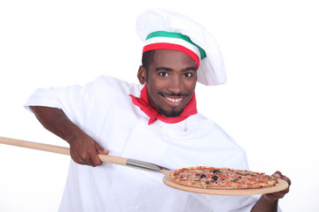 Italian chef with a pizza on a wooden peel