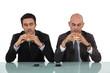 Two businessmen enjoying hamburgers