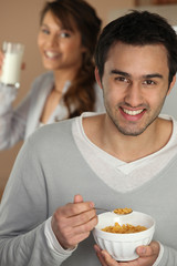 Man with a bowl of cereal