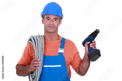 Electrician with wiring and cordless drill