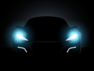 The car in the dark with the included headlights.