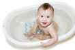 blue-eyed Baby swimming in the bath