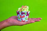colorful of Cupcake on women hand