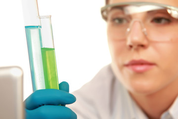 A medical  or doctor looking at a test tube