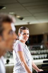 Woman Working Out At Health Club