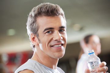 Man Holding Water Bottle In Health Club