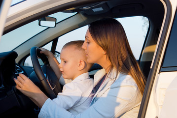 Mother teaching small son to drive