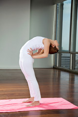 Fit Young Woman Practicing Yoga