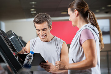 Instructor With Client In Health Club