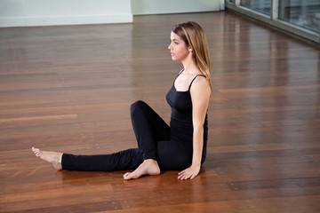 Young Fit Woman Practicing Yoga