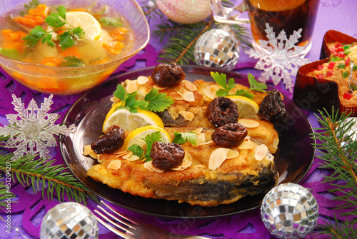 fried carp with almonds and prune for christmas - 45120420