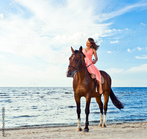 girl with horse on seacoast