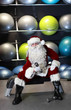 Santa Claus preparing for Christmas in gym