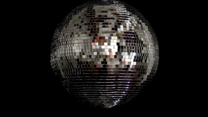 a funky discoball spinning and reflecting light. club visuals
