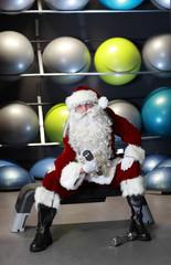 Santa Claus preparing for Christmas in gym