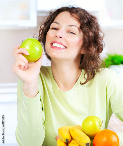 Diet. Happy Young Woman Eating Fresh Fruit
