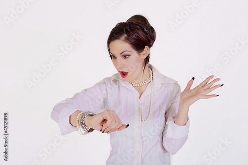 young businesswoman checks time on her wrist watch