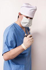 Surgeon in scrubs with scissor