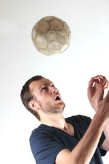 guy with football making a header