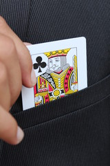 Pulling the King Card of the pocket